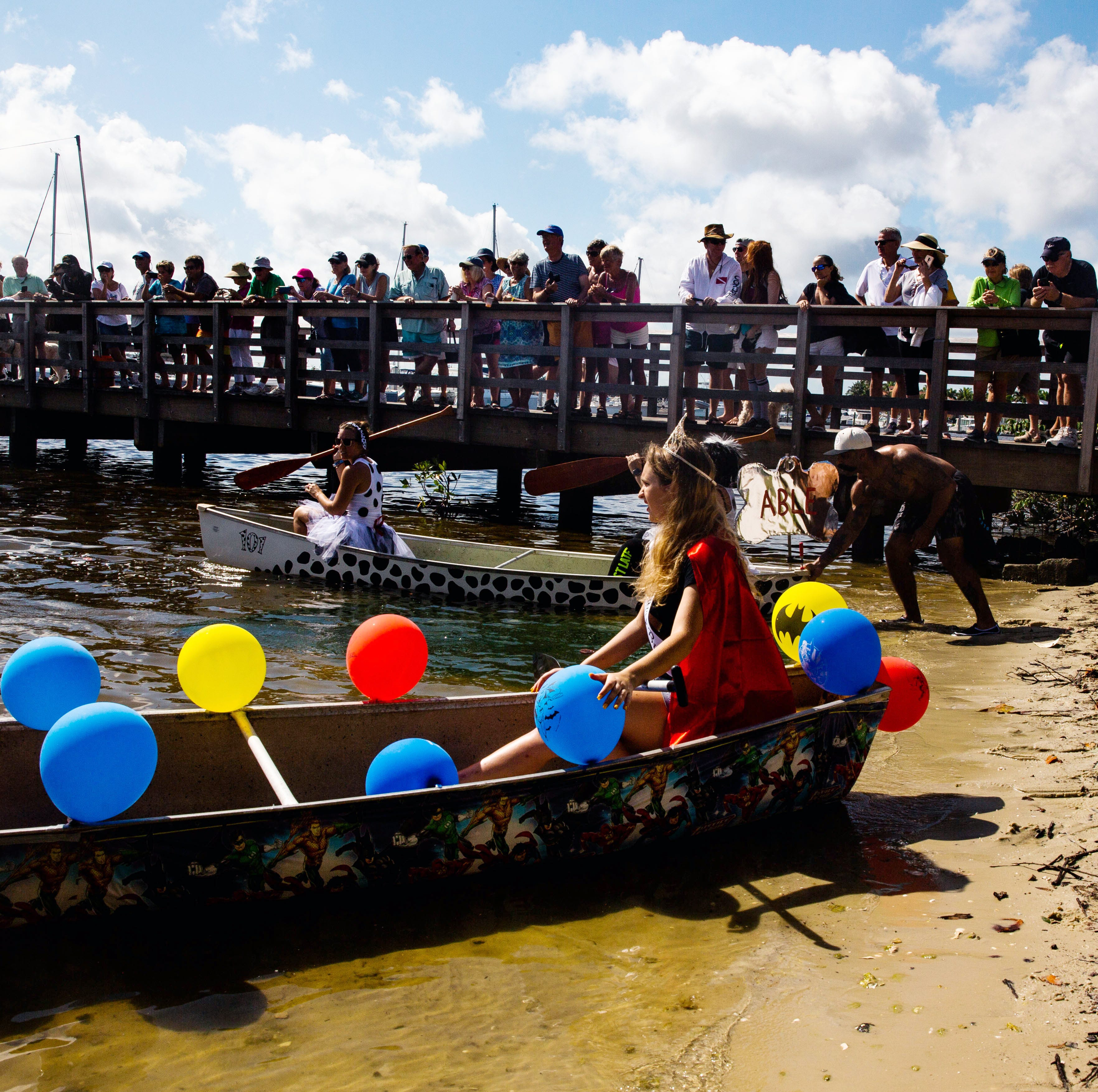 Hundreds of spectators enjoy the 43rd annual Great Dock Canoe Race in Naples