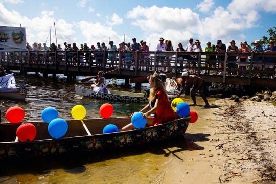 "Participants get in their canoes for the Theme Canoe Parade at the 43rd annual Great Dock Canoe Race in Naples on Saturday, May 11, 2019. The theme this year was ""Heroes and Villains."""