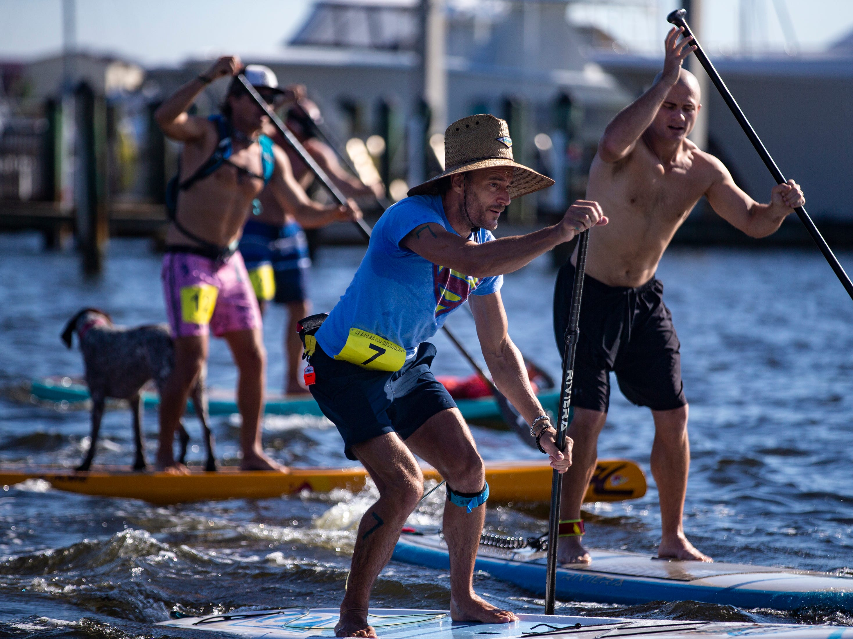 Simon Tracy of Naples competes in the amateur stand up paddleboard race, Saturday, May 11, 2019, during the 43rd annual Great Dock Canoe Race at Crayton Cove in Naples.