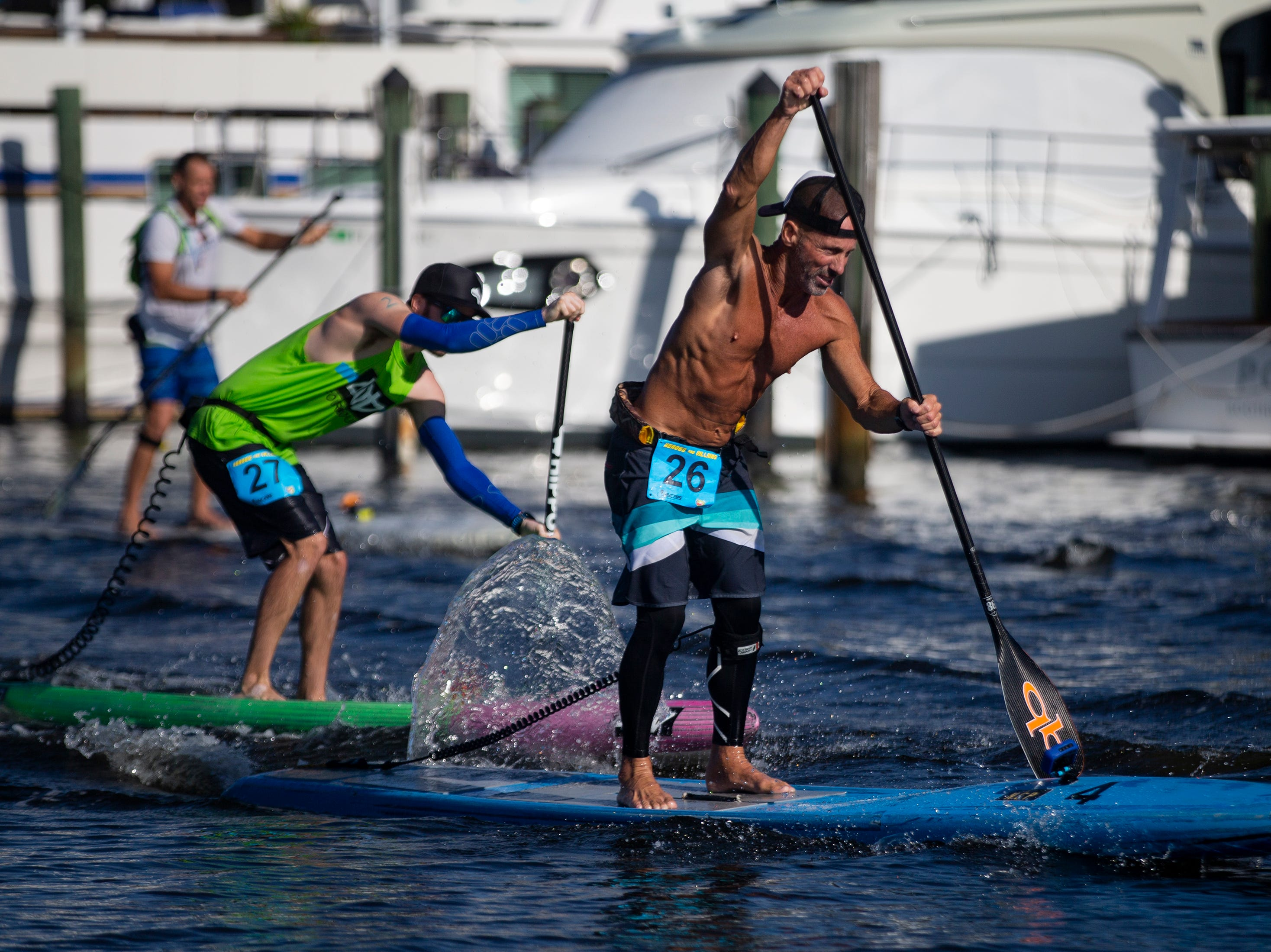 Mark Athanacio from Bonita Springs, competes in the professional paddleboard race, Saturday, May 11, 2019, during the 43rd annual Great Dock Canoe Race at Crayton Cove in Naples.