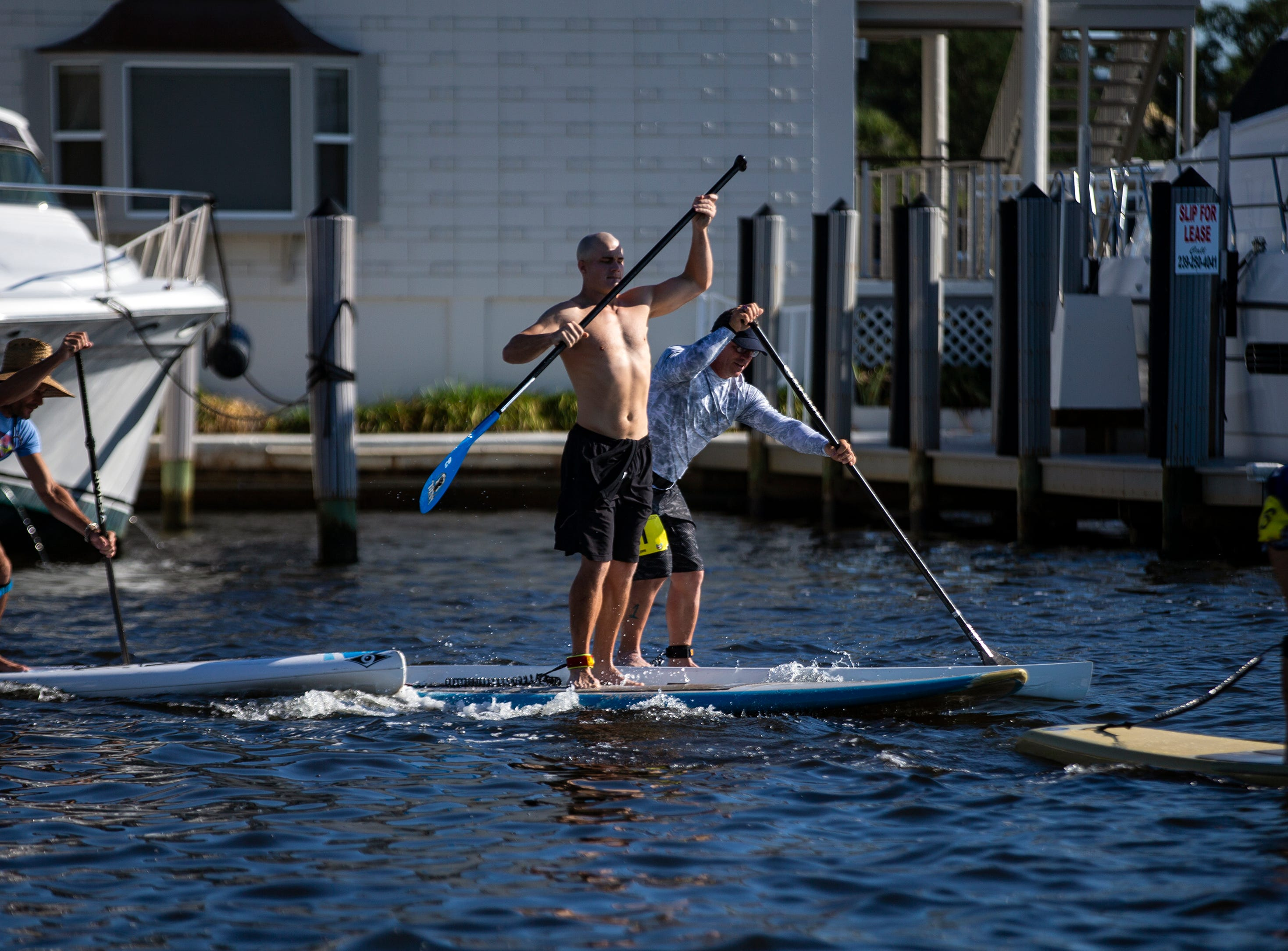 Amateur stand up paddleboard racers compete, Saturday, May 11, 2019, at the 43rd annual Great Dock Canoe Race at Crayton Cove in Naples.