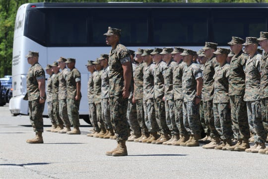 165 Marines from G Company, 2nd Battalion, the 25th Marines, who spent the last year in Afghanistan, stand at attention as they arrive home. Family and friends are reunited with them at Picatinny Aresenal in Rockaway on May 11, 2019.