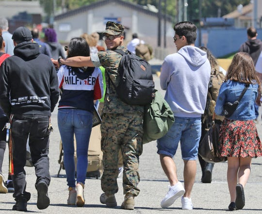 165 Marines from G Company, 2nd Battalion, the 25th Marines, who spent the last year in Afghanistan, head to their cars with family and friends as they are reunited at Picatinny Aresenal in Rockaway on May 11, 2019.