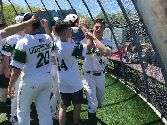 Passaic Valley teammates congratulate Steven Nitch (44) after he hit a two-run homer in a 10-1 victory over Lakeland in the Passaic County baseball tournament semifinals on Saturday, May 11, 2019.