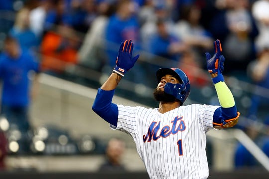 New York Mets' Amed Rosario celebrates after hitting a grand slam during the first inning of the team's baseball game against the Miami Marlins on Friday, May 10, 2019, in New York.