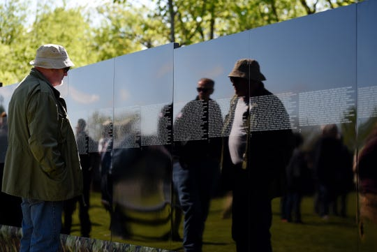 The dedication ceremony of the Traveling Vietnam Memorial Wall comes to Woodland Park on Saturday May 11, 2019. Norman Watt, a Paterson resident who served in the army from 1971-1975, reads the names on the memorial wall. Watt plans to read every name on the wall.
