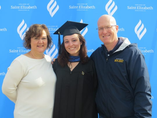 The College of Saint Elizabeth held Commencement 2019 exercises at the Mennen Arena in Hanover. May 11, 2019. Shown here is graduate student Kaley Stockhaus of Florence, with her parents, Irene and Philip.