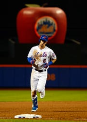 New York Mets' Jeff McNeil rounds third base after hitting a solo home run during the third inning of a baseball game against the Miami Marlins on Friday, May 10, 2019, in New York.