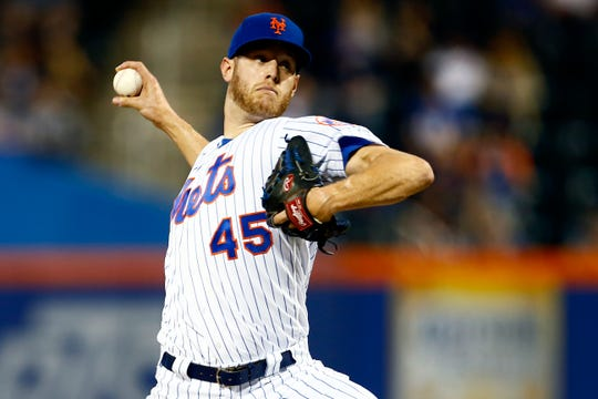 New York Mets pitcher Zack Wheeler throws during the third inning of the team's baseball game against the Miami Marlins on Friday, May 10, 2019, in New York.