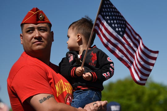 The dedication ceremony of the Traveling Vietnam Memorial Wall comes to Woodland Park on Saturday May 11, 2019. Helman Fava holds son Damian Fava, 2 years old from Totowa.