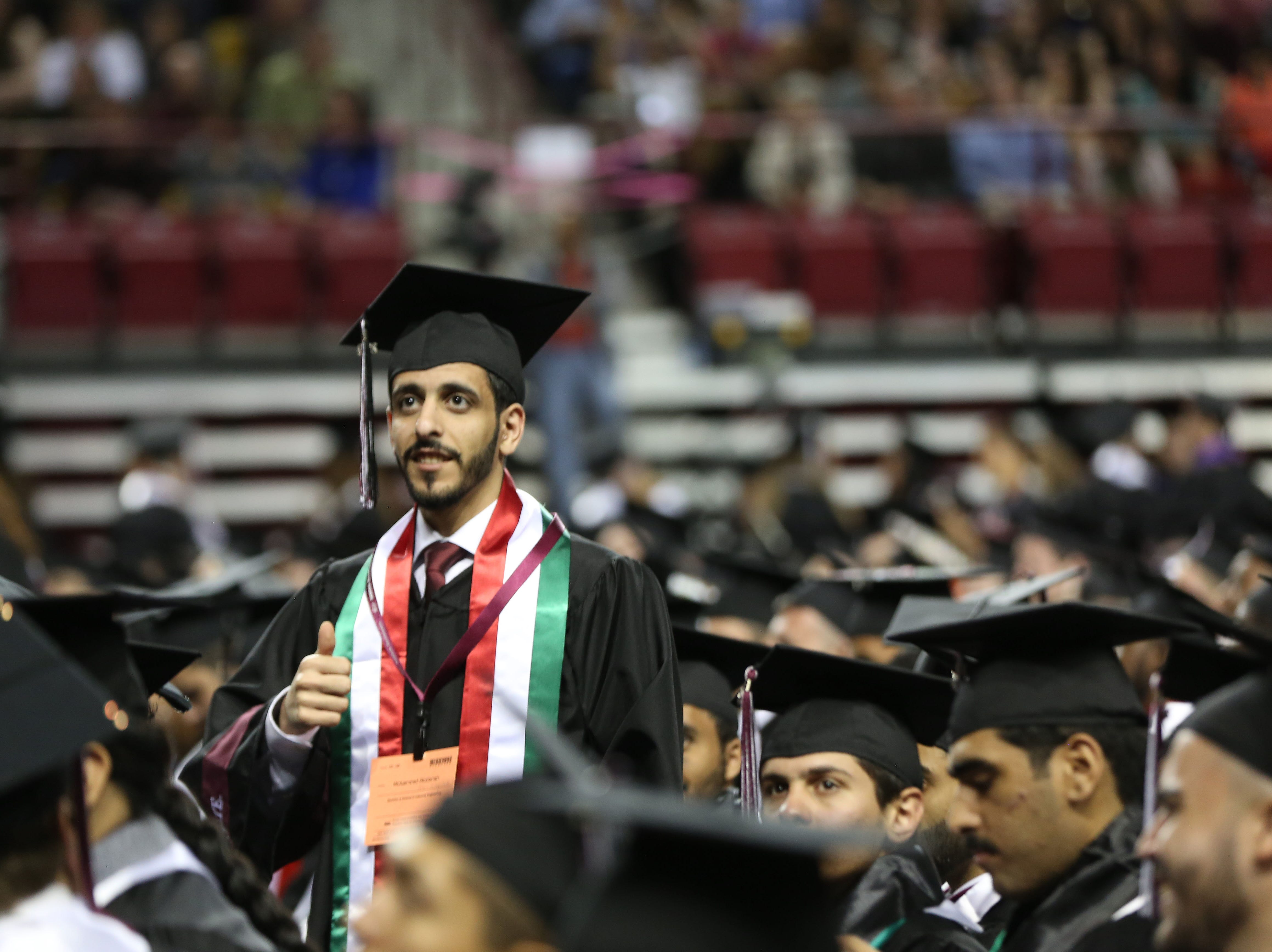 "A student gives the ""thumbs up,"" sign, Saturday May 11, 2019, during New Mexico State Universities commencement ceremony."