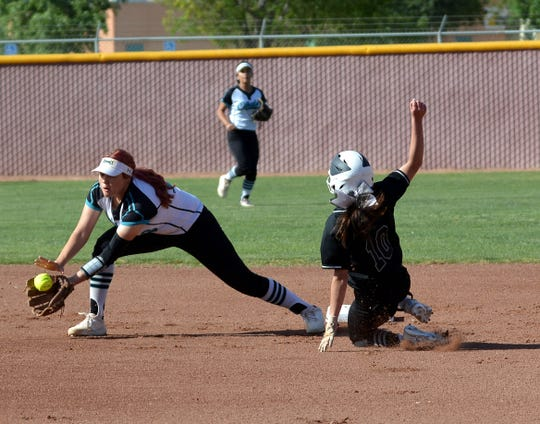 Oñate shortstop Samantha Barela stretches for the ball at second base as a Hobbs baserunner slides on Friday night at Field of Dreams.