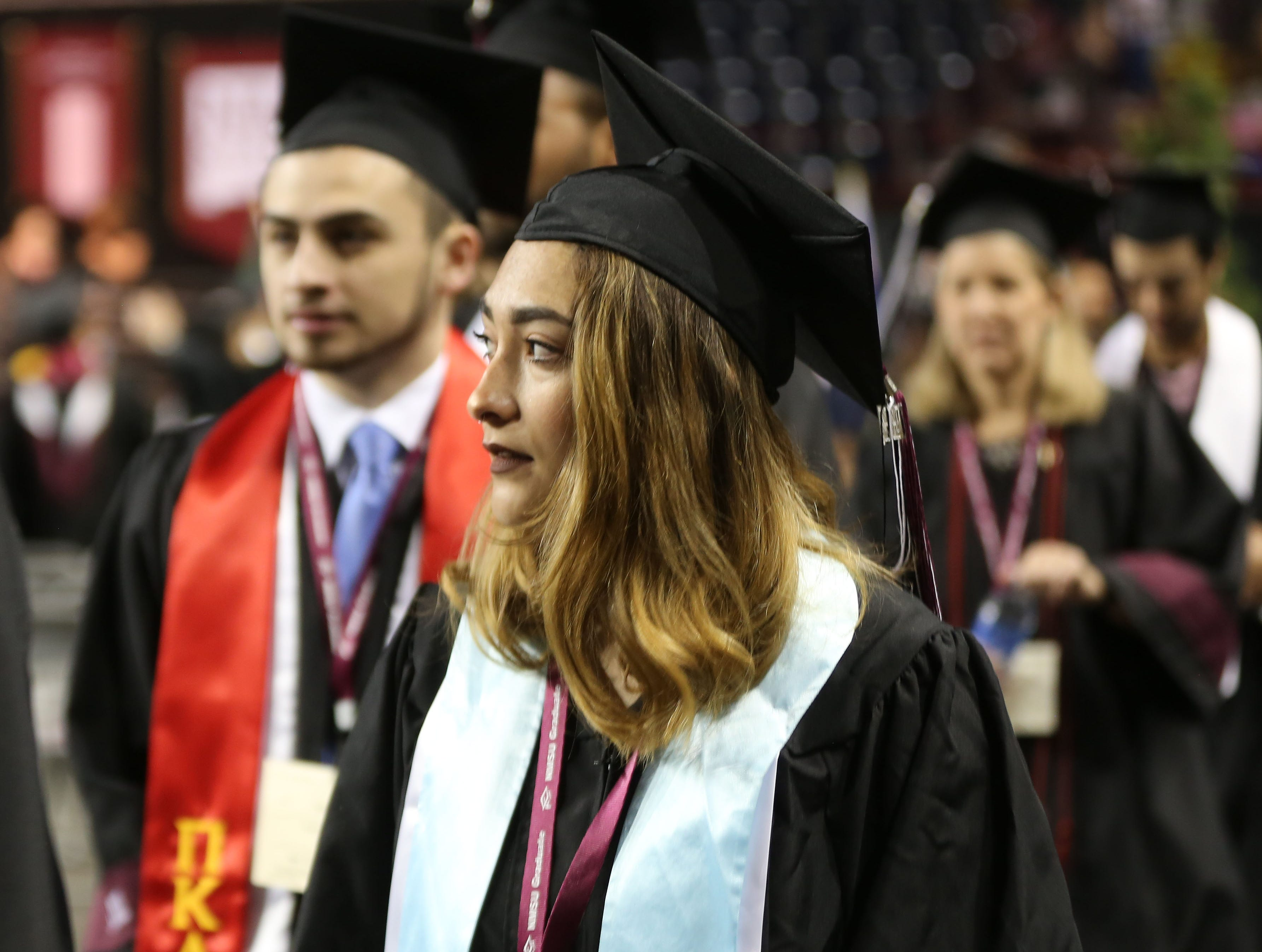 A student waits to receive her degree from New Mexico State University, at commencement, Saturday May 11, 2019.