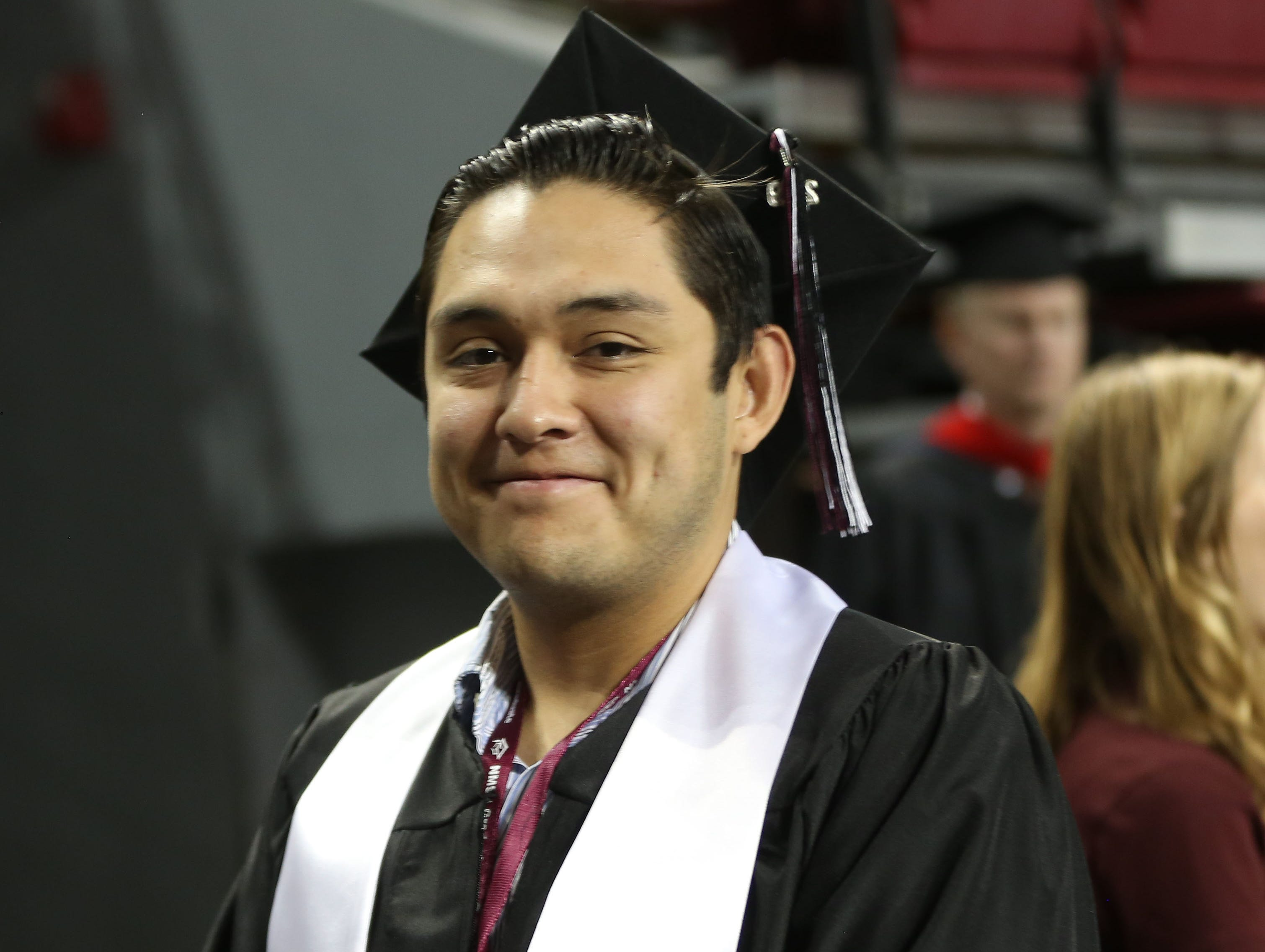 A student smiles proudly, after receiving his degree, Saturday May 11, 2019, at the New Mexico State University commencement ceremony.