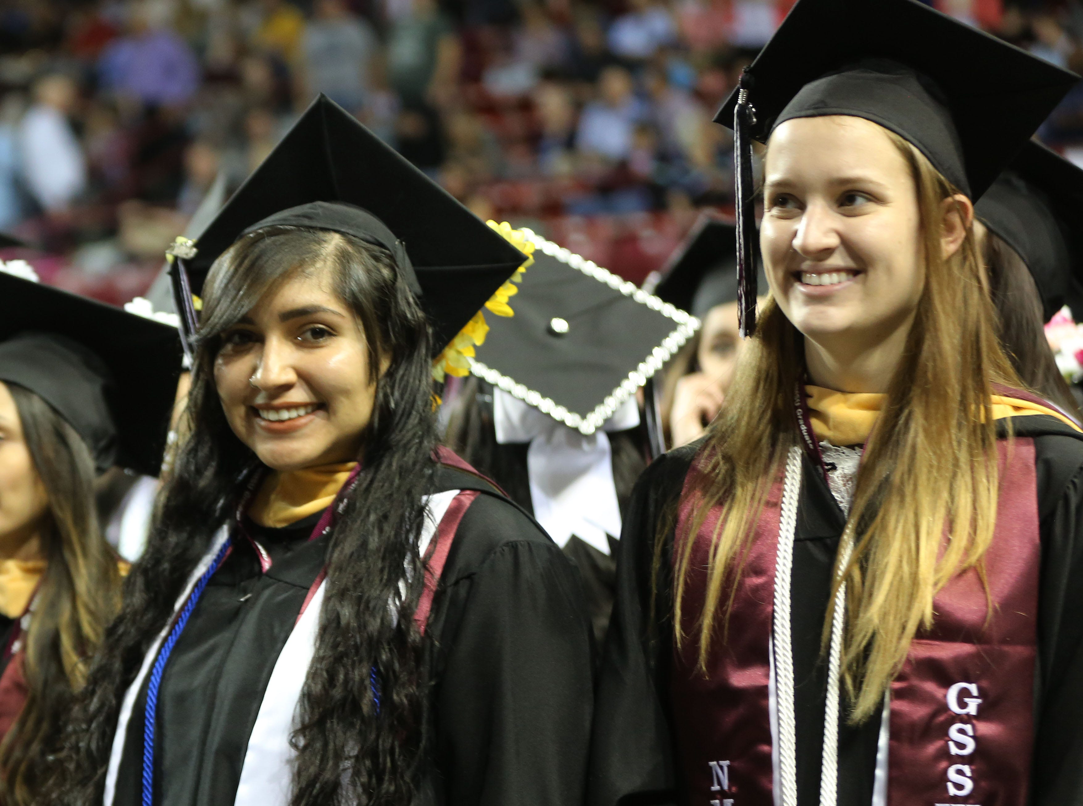 New Mexico State University students smile, as they wait to be seated during commencement, Saturday May 11, 2019.