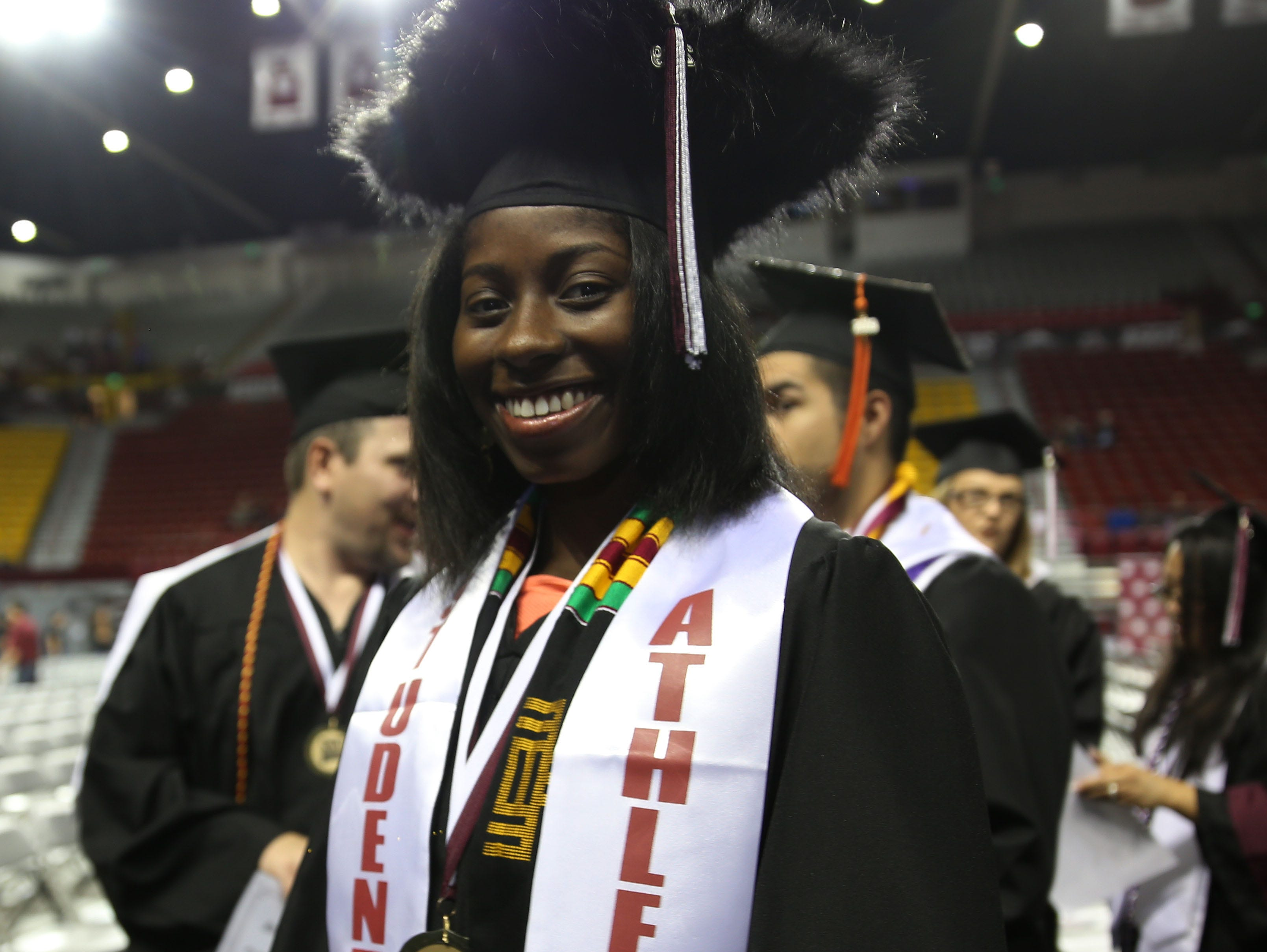 A New Mexico State University student athlete, now a graduate, smiles after receiving her degree, Saturday May 11, 2019.