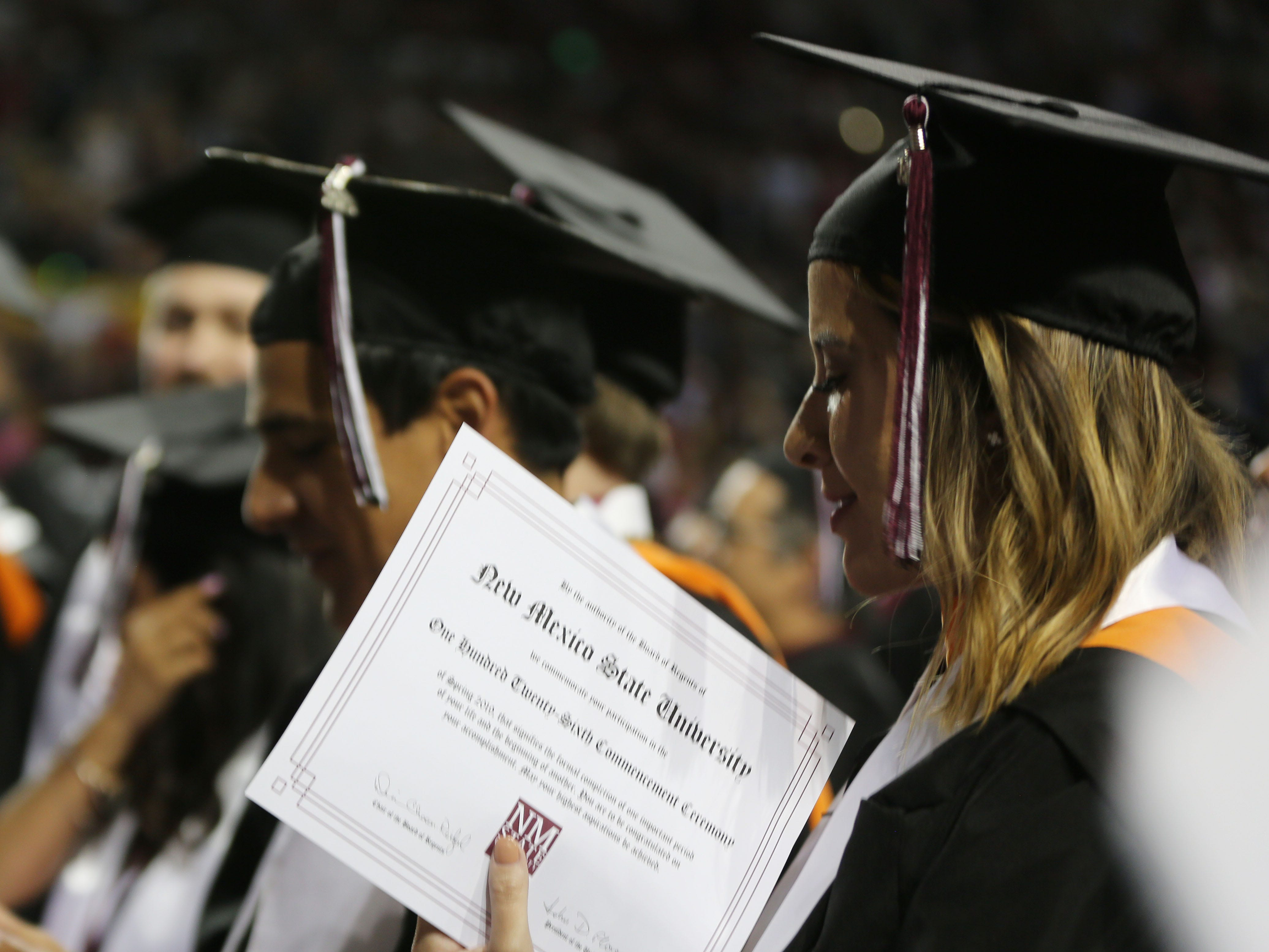 A New Mexico State University graduate unknowingly shows off her degree during the school's commencement ceremony, Saturday May 11, 2019.