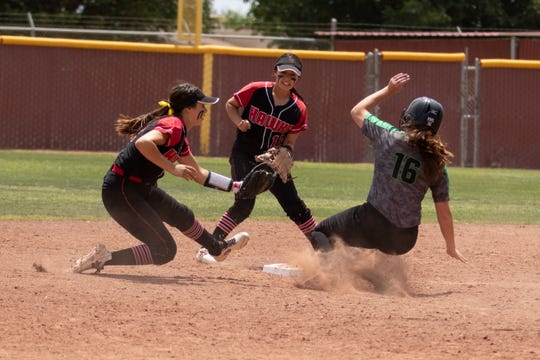 Centennial's Nicole Guillen tries to tag Farmington runner Nicole Brimhall. Centennial High School played Farmington High School in the first round of the State Tournament on Saturday at the Field of Dreams Softball Complex.