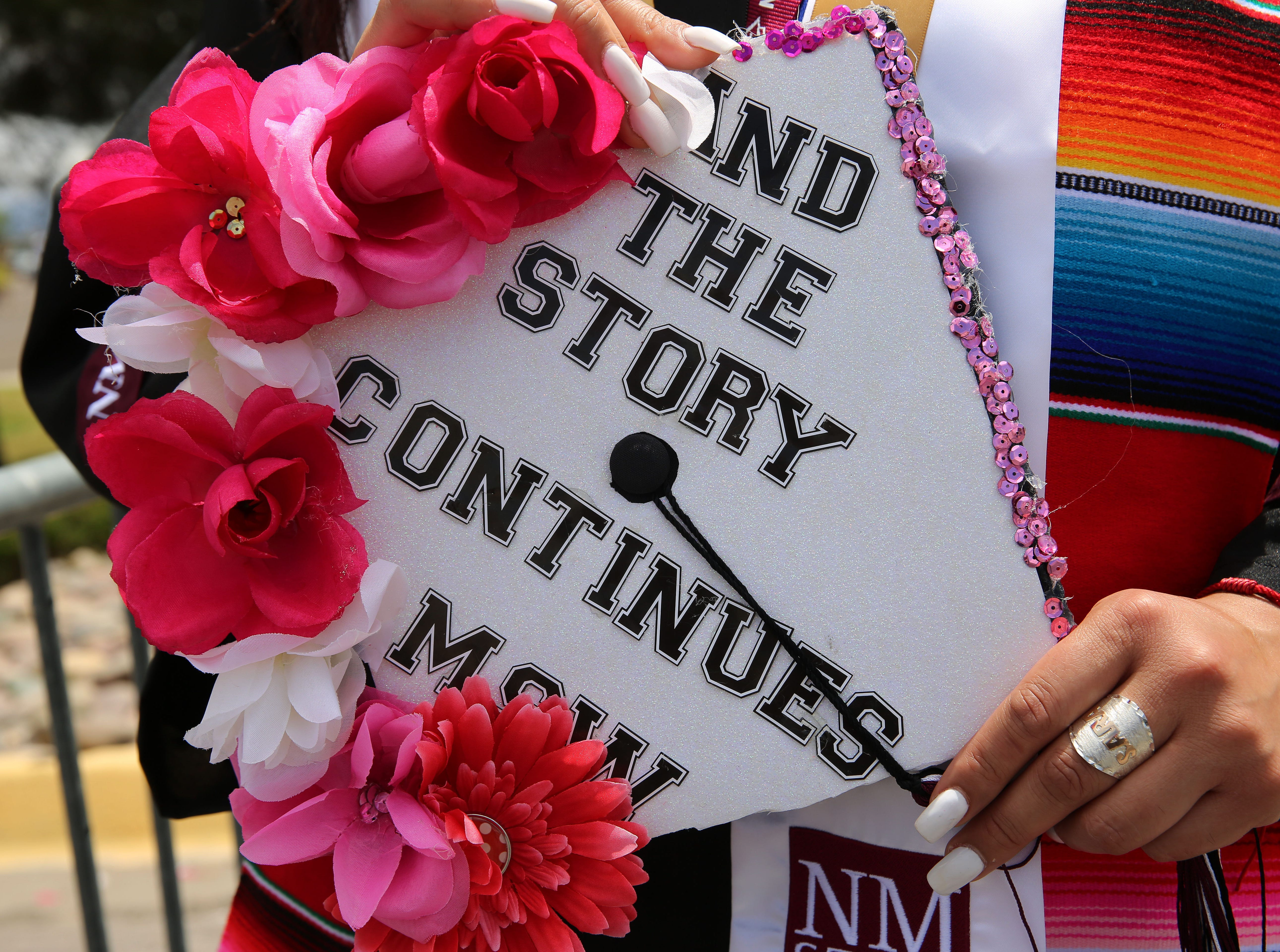 With the goal of helping others, Sarah Rodriguez earned a degree in social work, but she's not done yet. With a mortarboard expressing the sentiment, Rodriguez said she's continuing on in school, to complete her master's degree.