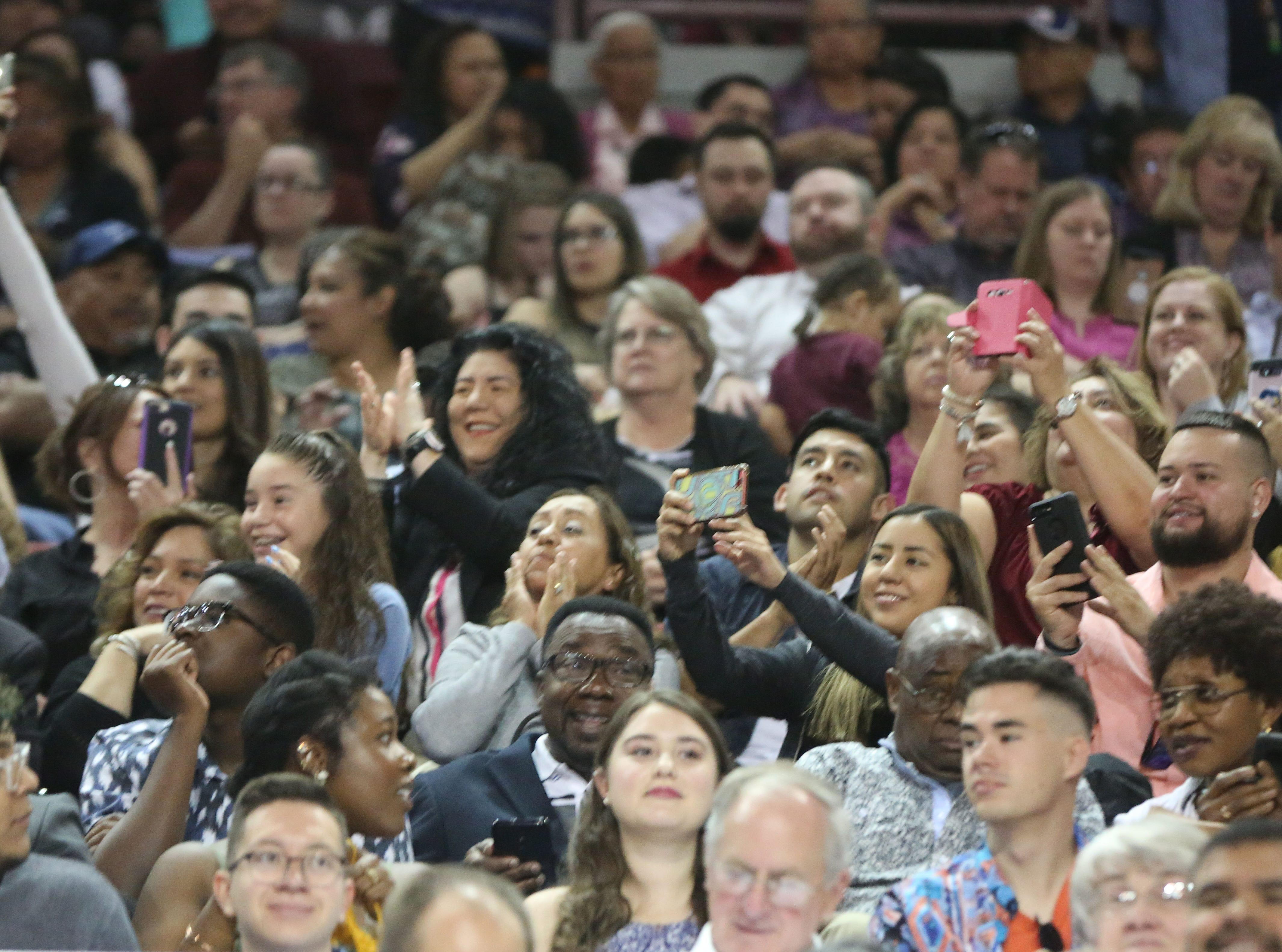 Family members cheer on their graduates during New Mexico State Universities commencement ceremonies Saturday May 11, 2019.