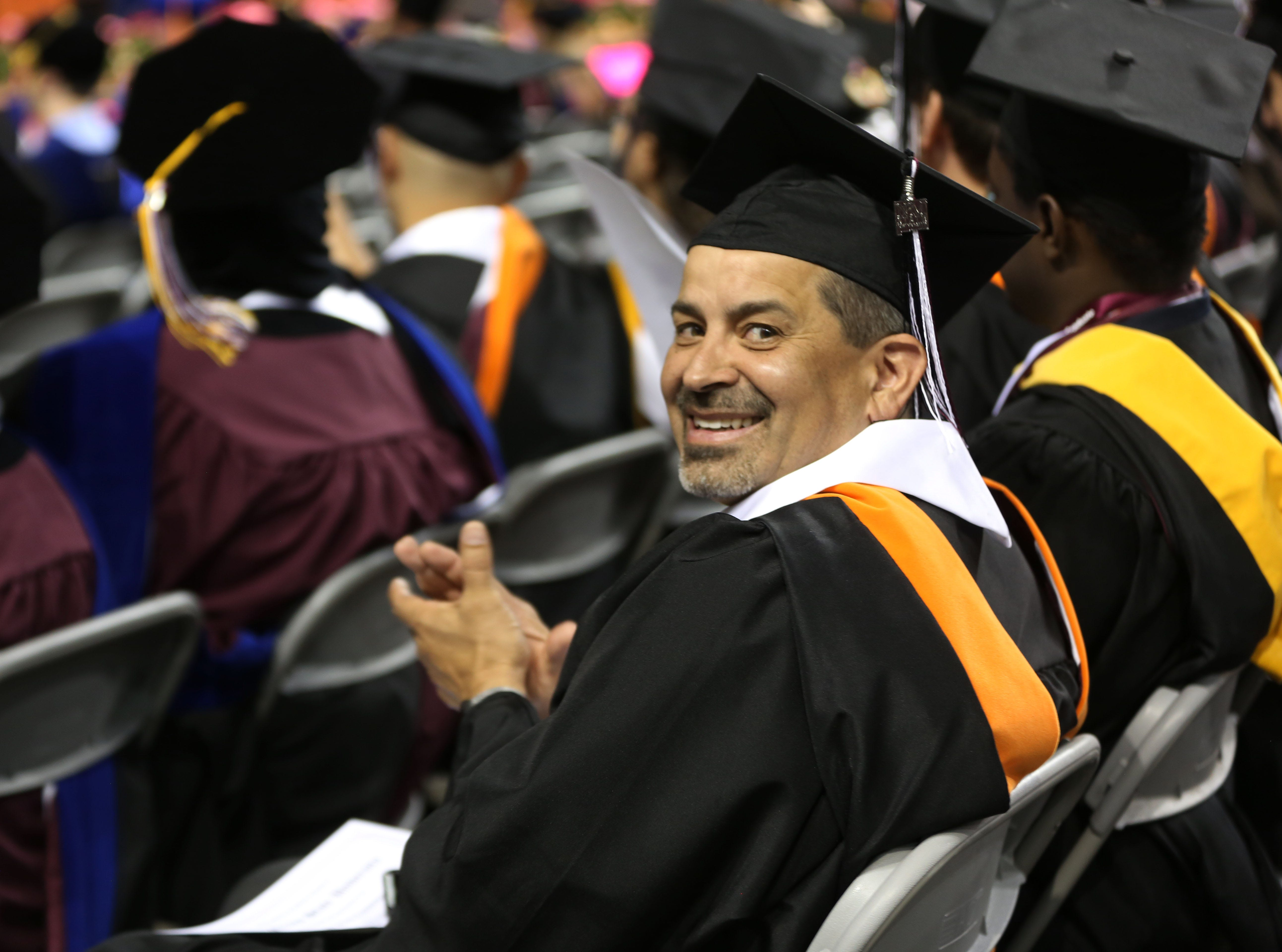 A New Mexico State University student smiles, after receiving his degree at a commencement ceremony, Saturday May 11, 2019.