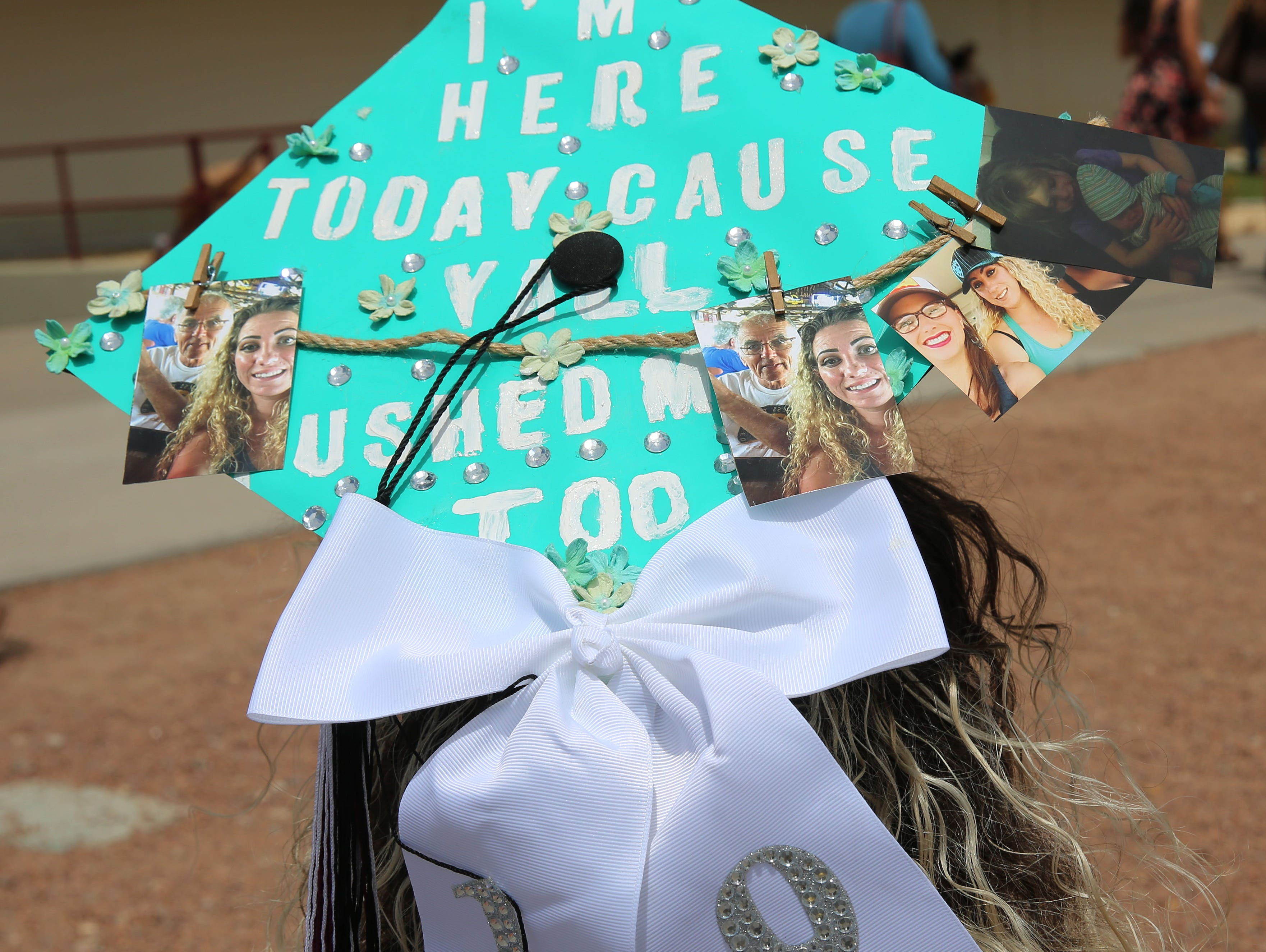 Mariana Fountain has always been interested in agriculture, and the way the business is run. That's why she earned a Bachelor of Arts degree in agricultural economics and business, with minors in finance and marketing. The mother or two, said her kids helped push her through school, so she decorated her hat in honor of them.