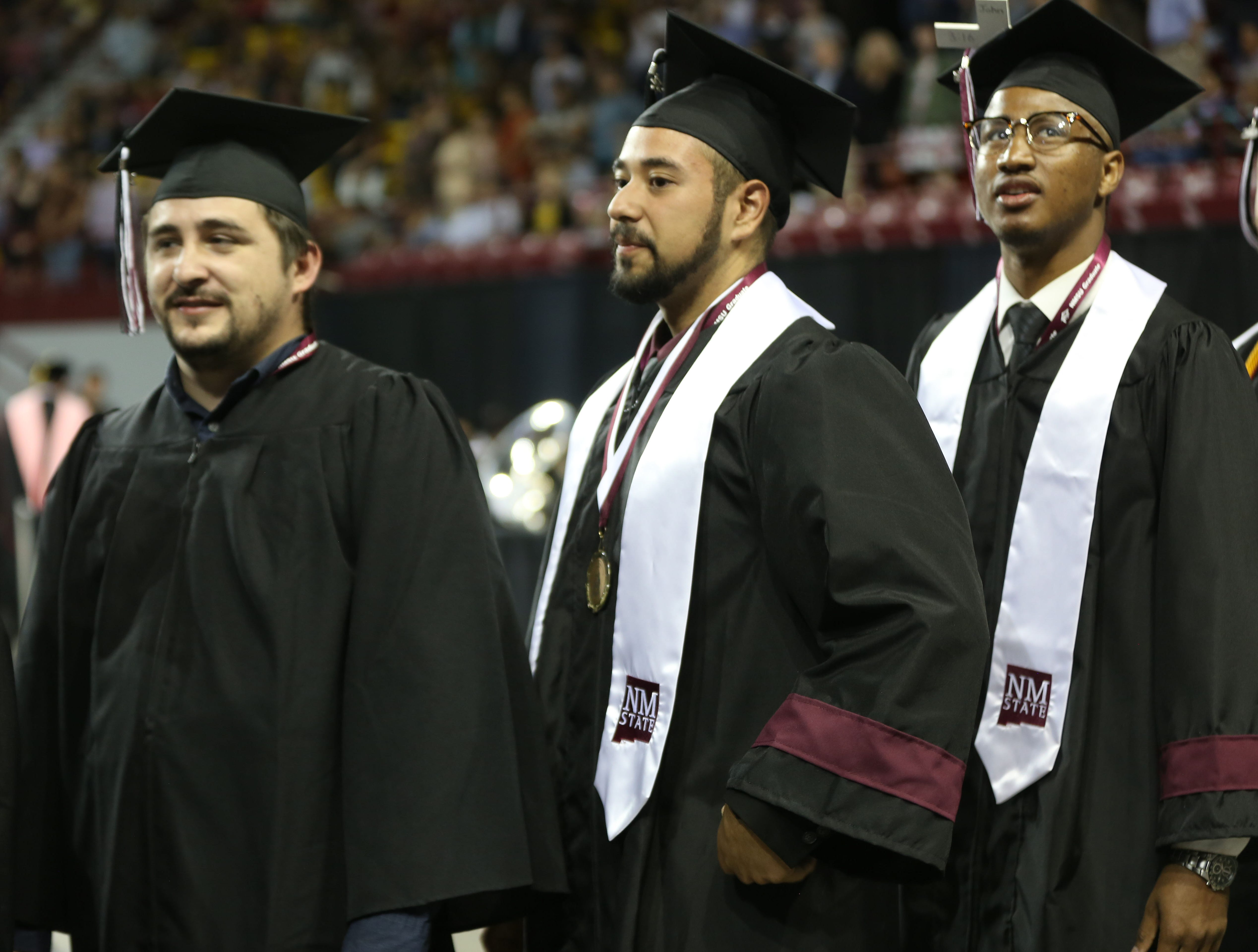 New Mexico State University students enter the stadium for their graduation ceremony, Saturday May 11, 2019.