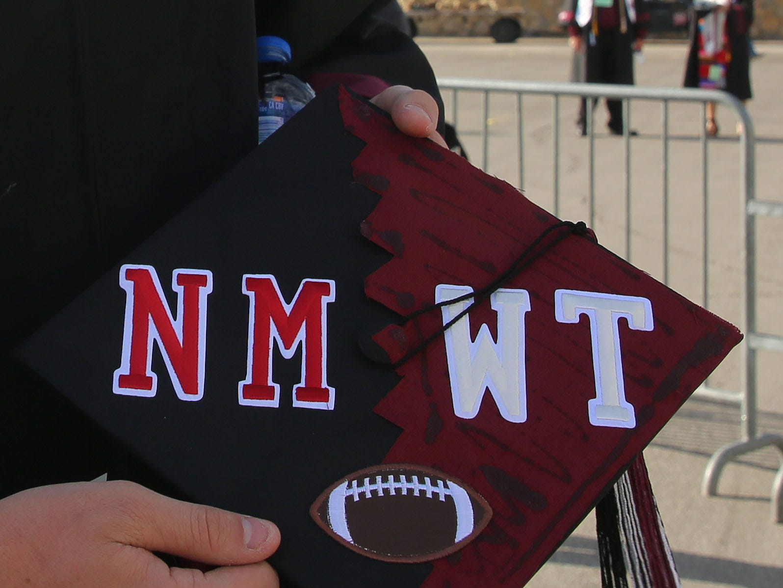 Eventually, Garrett Gibson, who earned a degree in general business entrepreneurship, wants to start his own business. He's not quite sure what his business will be, but it's definitely something he's excited about. His first two years of college were spent playing football at West Texas A&M University, and his last two years were spent at New Mexico State. HIs mortarboard reflects what he learned at both schools, he said.