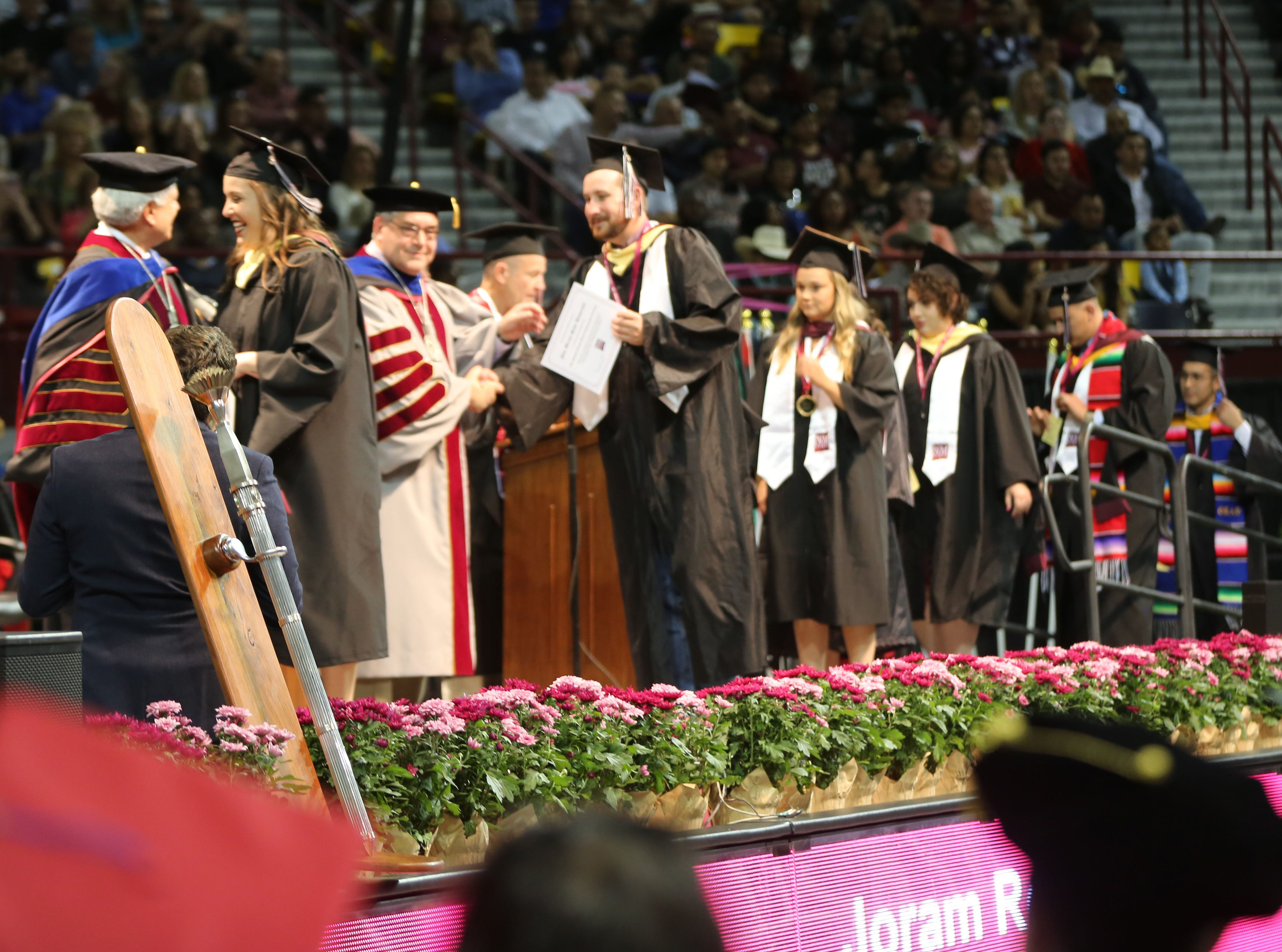 A total of 1,460 students earned their bachelor's degree this year at New Mexico State University.