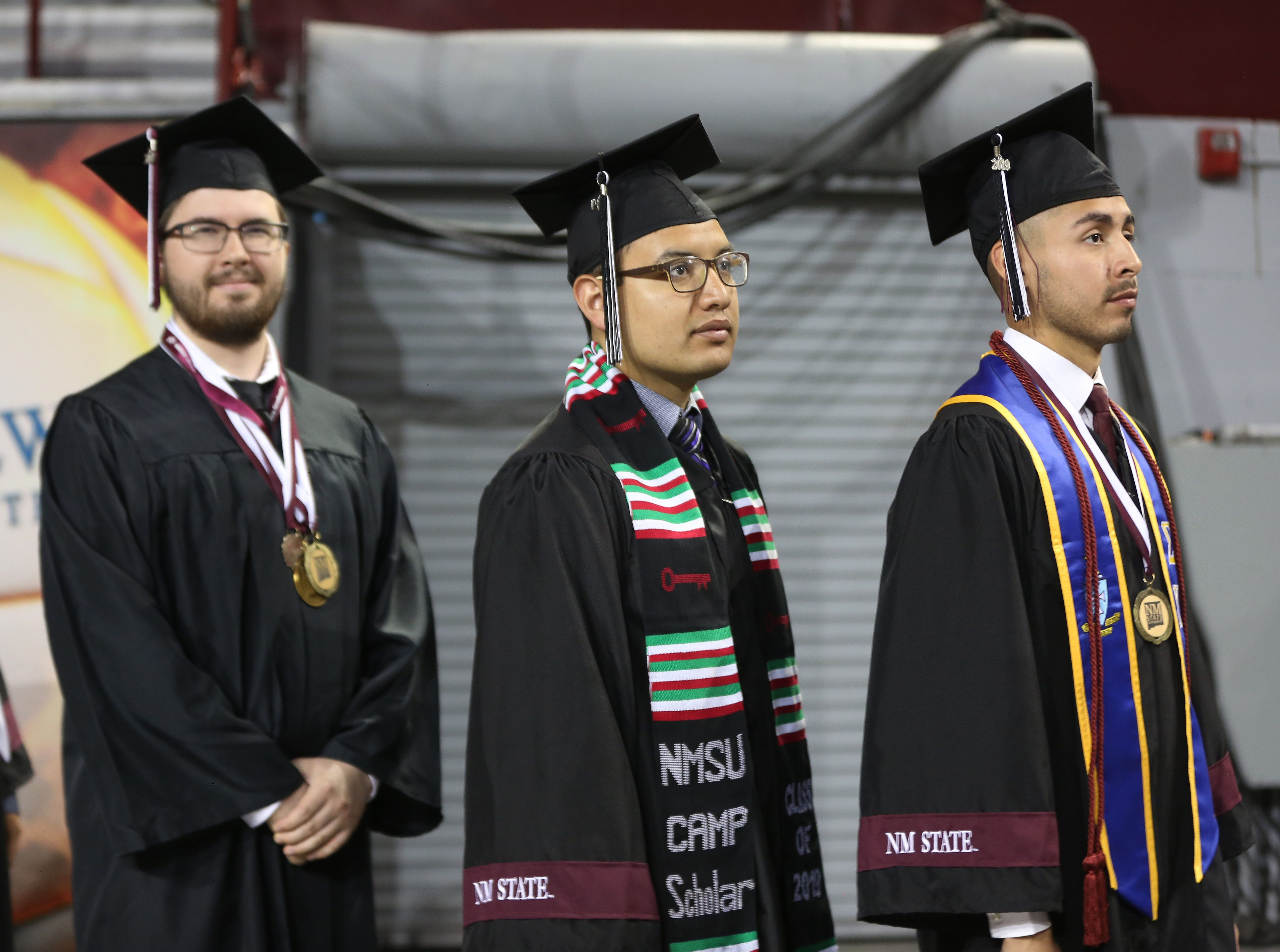 New Mexico State University students enter the stadium at the Pan American building in Las Cruces, for commencement, Saturday May 11, 2019.