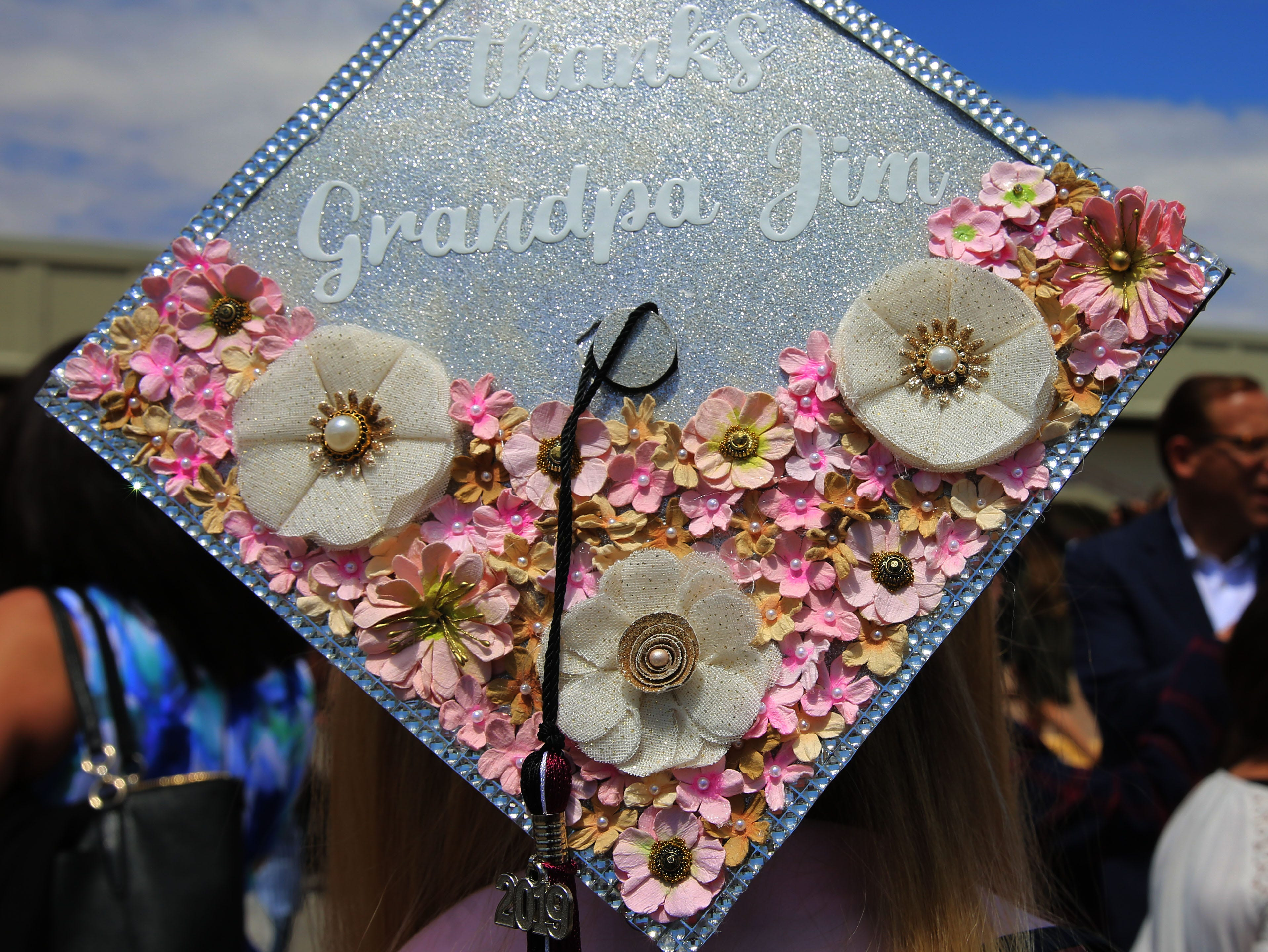 Allison Plummer, who earned a degree in animal science, said she was in high school, when she found out her grandfather left an educational trust for his grandchildren, to ensure they could go to college, without having to worry about money. Because of her grandfather's gift, Plummer said she was able to finish school debt free, so she decorated the mortar board on her cap to honor the man who gave her so much.