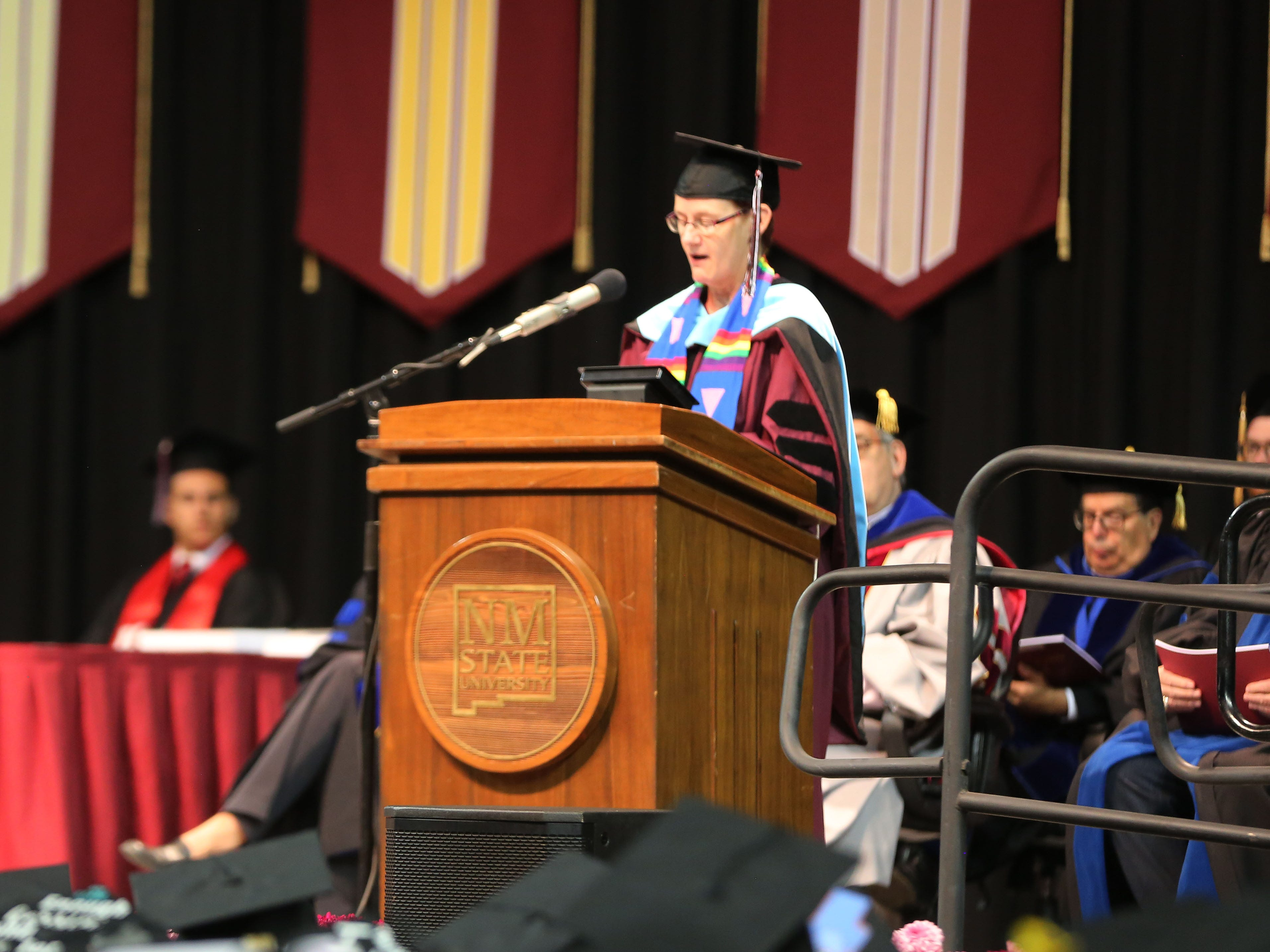 "2019 Aggie commencement speaker Mary Prentice, an associate professor in the school of Teacher Preparation, Administration and Leadership at New Mexico State University, implored graduates Saturday May 11, 2019, to live courageously. ""Commit to the journey, even if you feel afraid,"" she said."