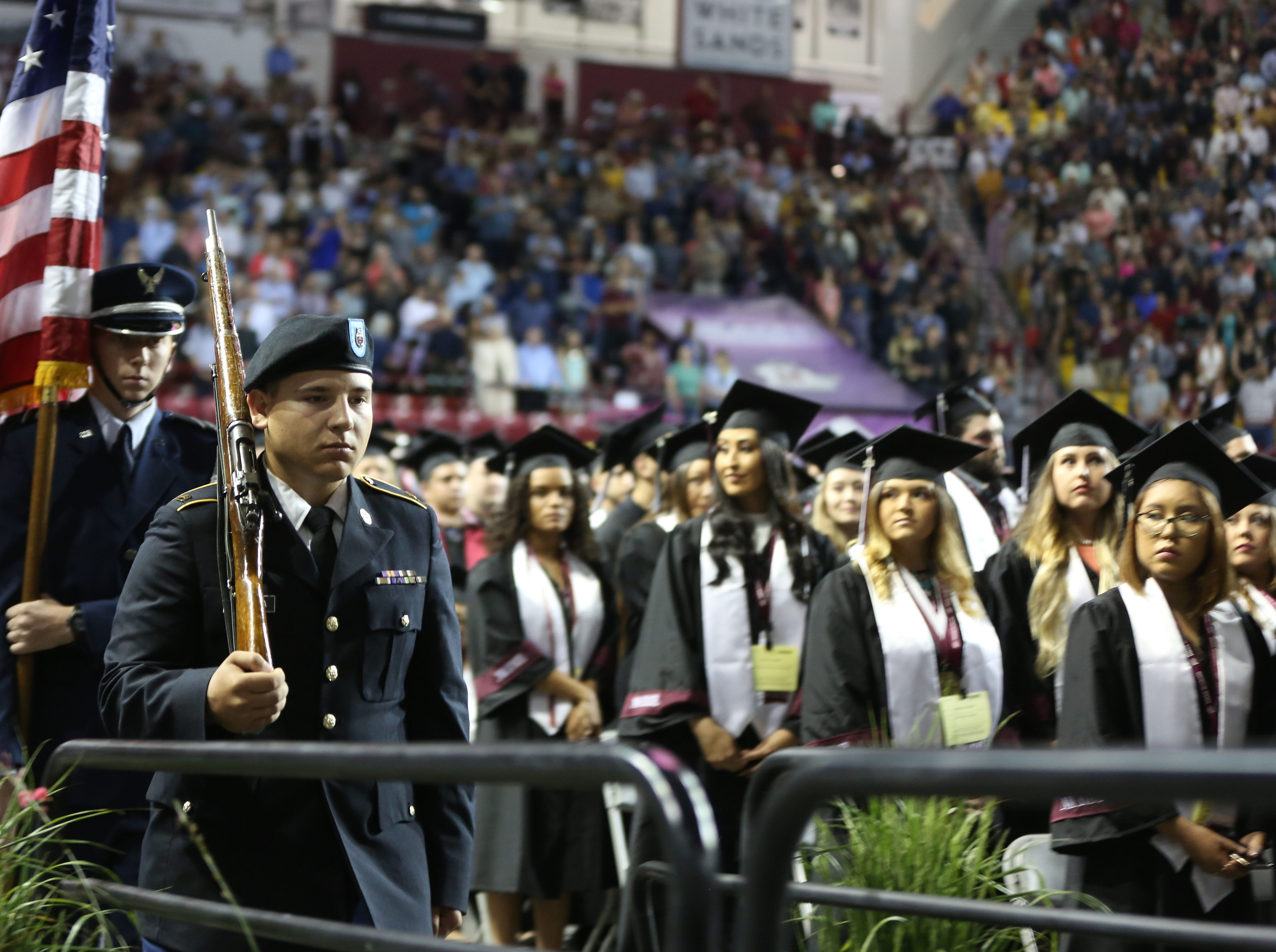 ROTC members present colors during New Mexico State Universities commencement ceremony, Saturday May 11, 2019.