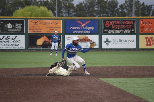 Josh Echavarria takes the throw from the pitcher while trying to pick off Hobbs' Colton Graham in the fifth inning Friday night. Graham was safe, but the Cavemen won the game 7-6 in eight innings.