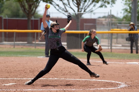 Farmington's Makayla Donald throws a pitch during Saturday's 5A playoff softball game at Centennial.