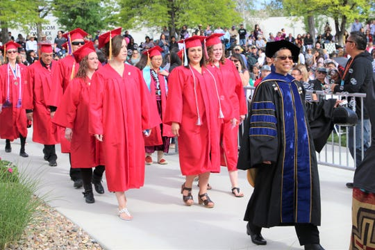 Frances Vitali, an instructor in the teacher education program at the University of New Mexico's San Juan Center, leads UNM graduates to the spring Commencement Ceremony on May 11.