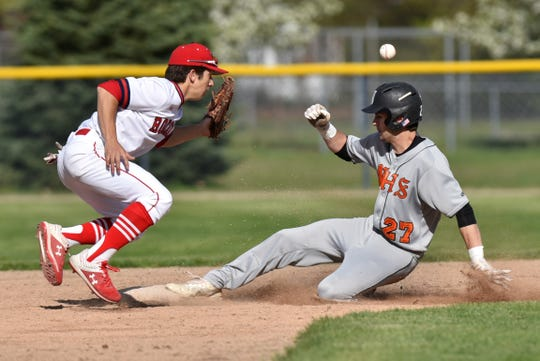 Mustang Spencer Ziparo gets into second base ahead of the ball and a tag by Ed Sajewski.