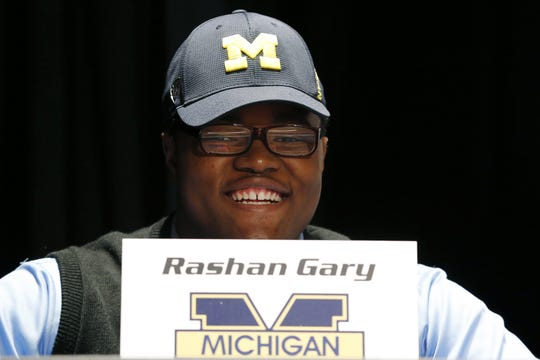 Paramus (N.J.) Catholic High School defensive tackle Rashan Gary smiles during a school rally in Paramus, N.J., after announcing he would attend Michigan on national signing day, Feb. 3, 2016.