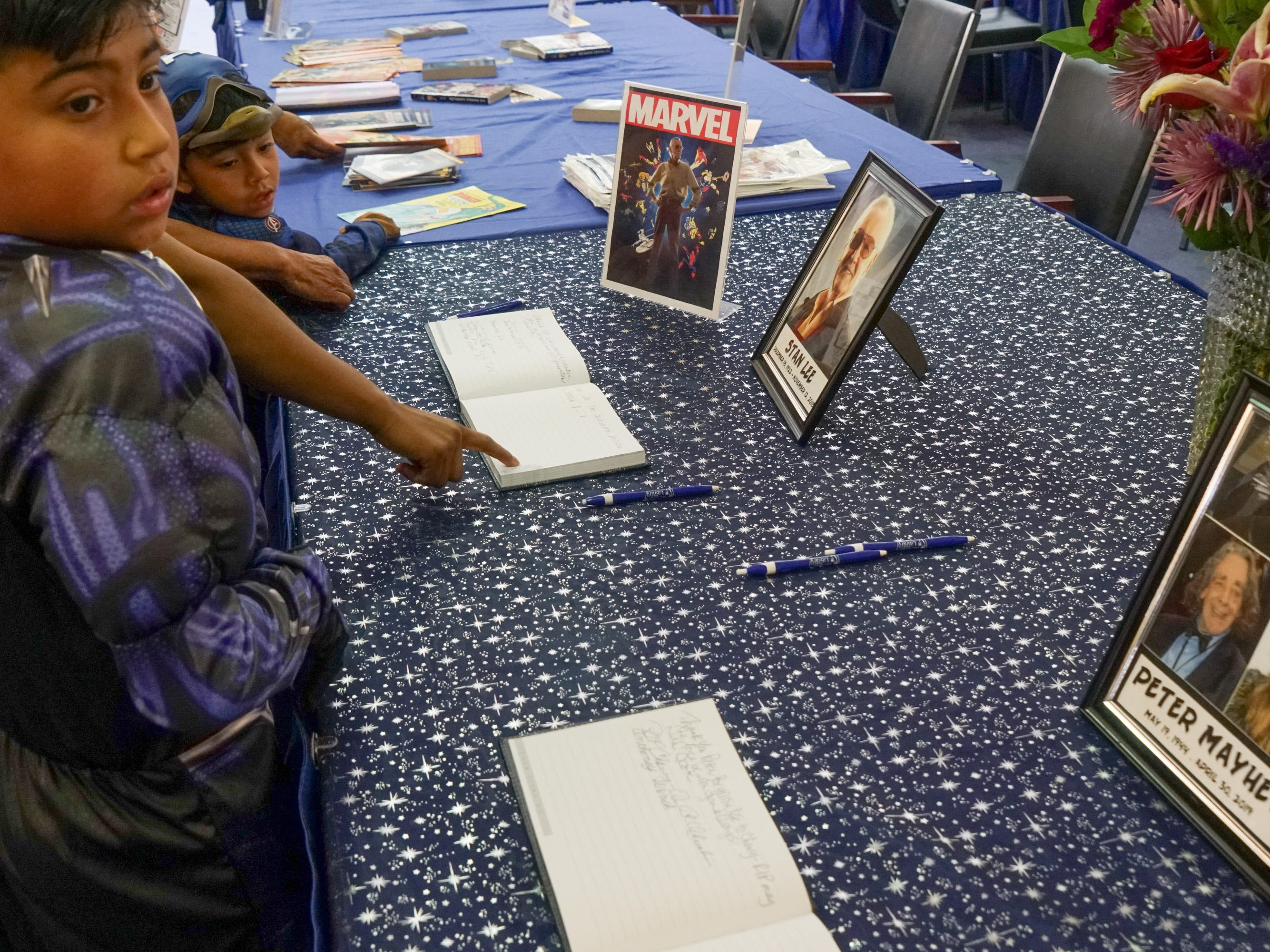 Books are signed at the Palm Springs Public Library Comic Con in remembrance of Stan Lee and Peter Mayhew, Palm Springs, Calif., May 11, 2019.