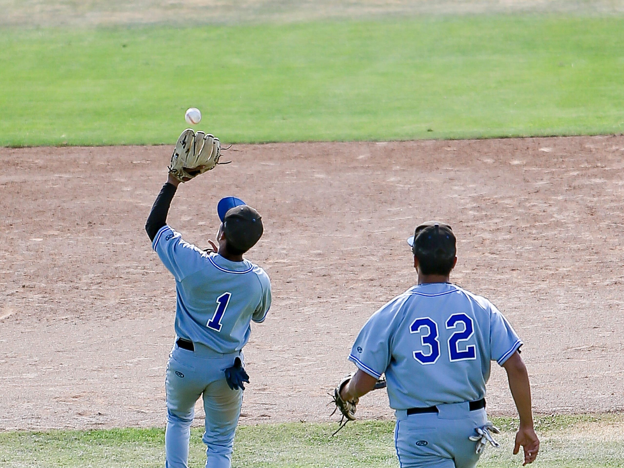 Century's Norberto Herrera hauls in a fly ball Friday.