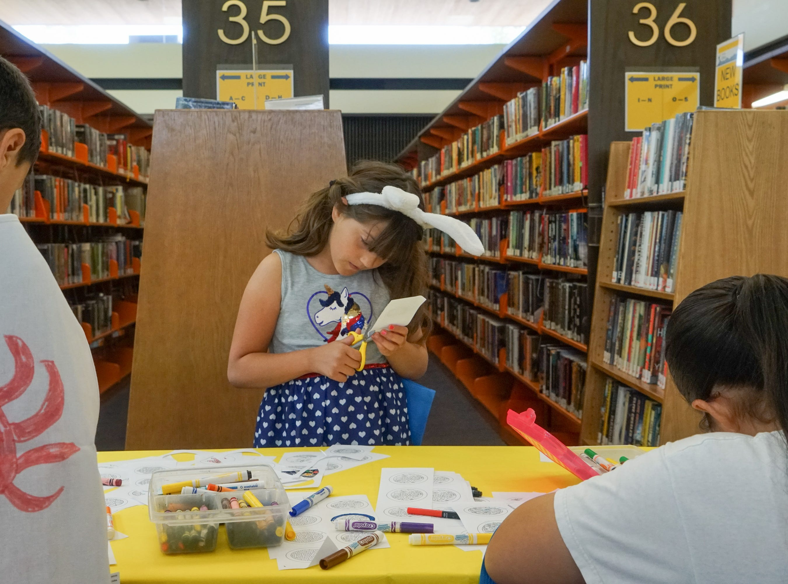 Kids make their own buttons at an activity table at the Palm Springs Public Library Comic Con, Palm Springs, Calif., May 11, 2019.