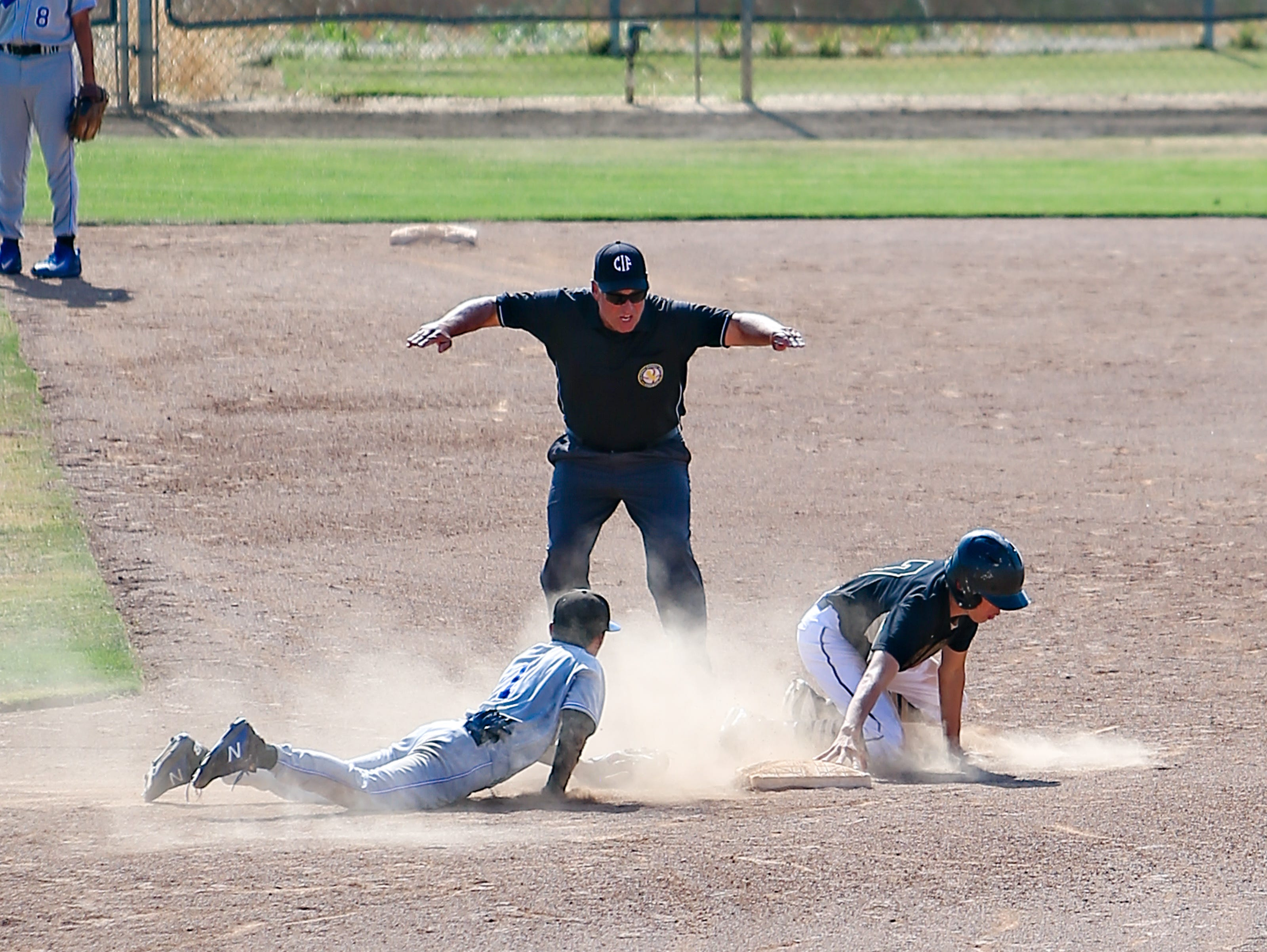 Xavier Prep runner Alex Brito is safe at second base during the Saints 5-4 Division 5 quarterfinal win.