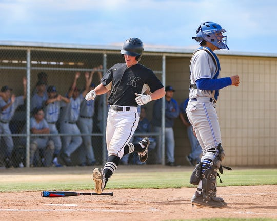Xavier Prep's Blake Powers scores one of his three runs during the Saints' 5-4 quarterfinal win over Century on Friday.