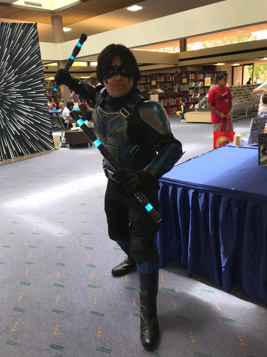 Mitchell Delgadillo of Indio adorned his Nightwing costume at the Palm Springs Public Library on Saturday, May 11.
