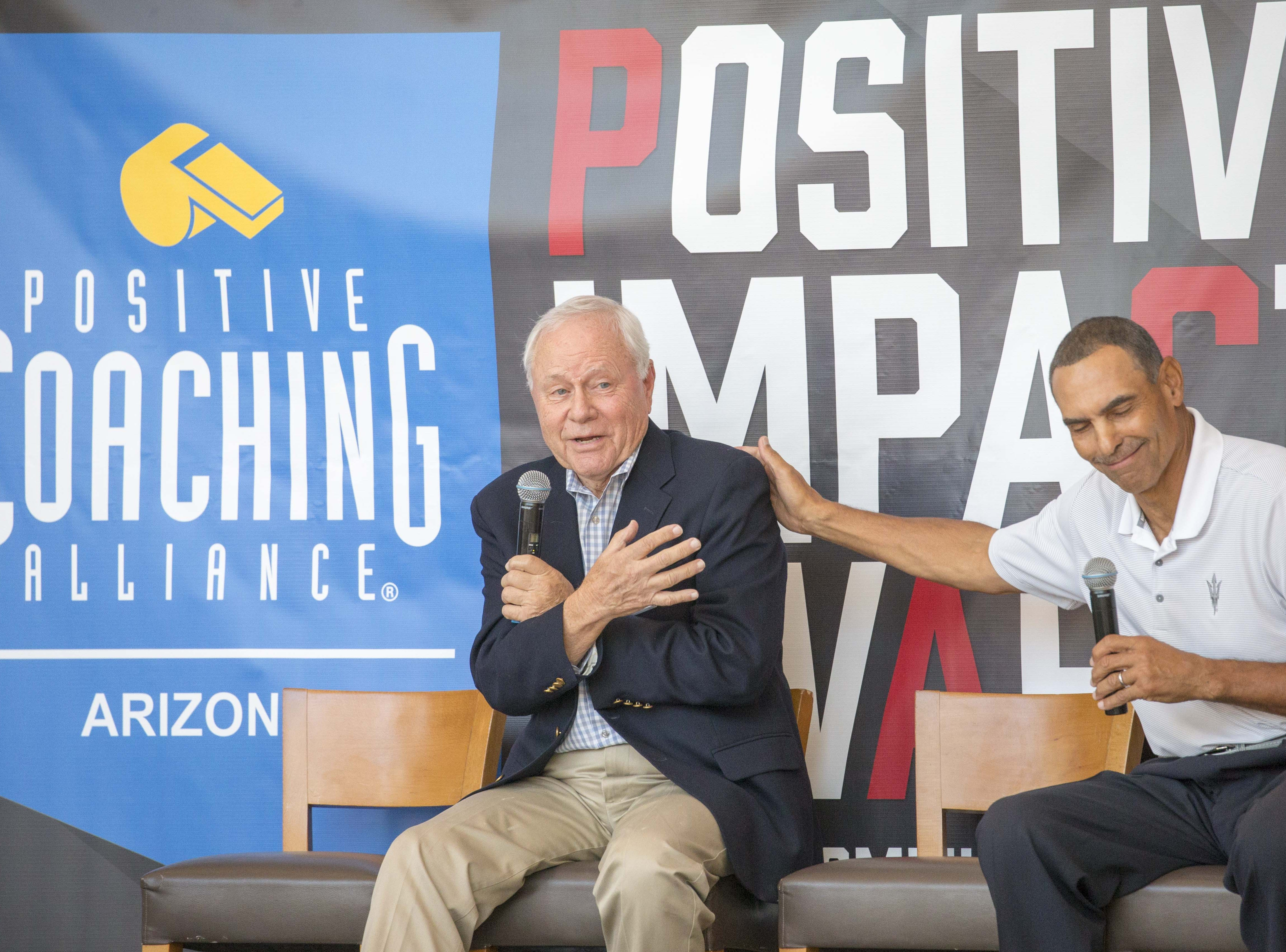 Former Arizona coach Dick Tomey, left, and ASU coach Herm Edwards share a laugh during The Positive Coaching Alliance-Arizona event.