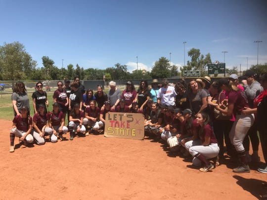 Salpointe Catholic poses with a sign for their state tournament, Saturday, May 11, 2019.