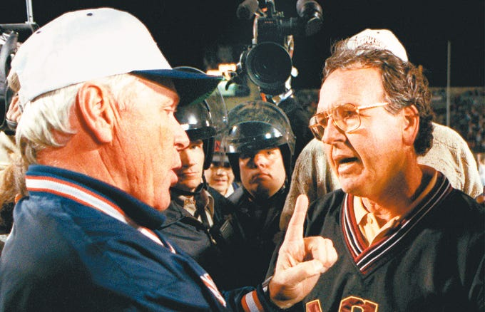 Arizona football coach Dick Tomey has some choice words for Arizona State coach Bruce Snyder after the Sun Devils thrashed the Wildcats 56-14 on Nov. 23, 1995, in Tucson.