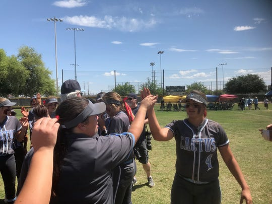 Cactus shortstop Alynah Torres high-fives teammates and coaches, Saturday, May 11, 2019.