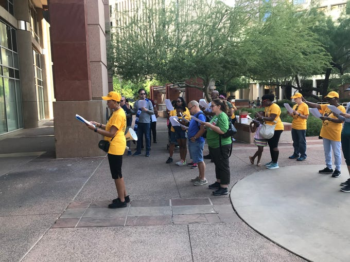 Members of the Black Mothers Forum read a prayer in front of Phoenix City Hall on May 11, 2019.