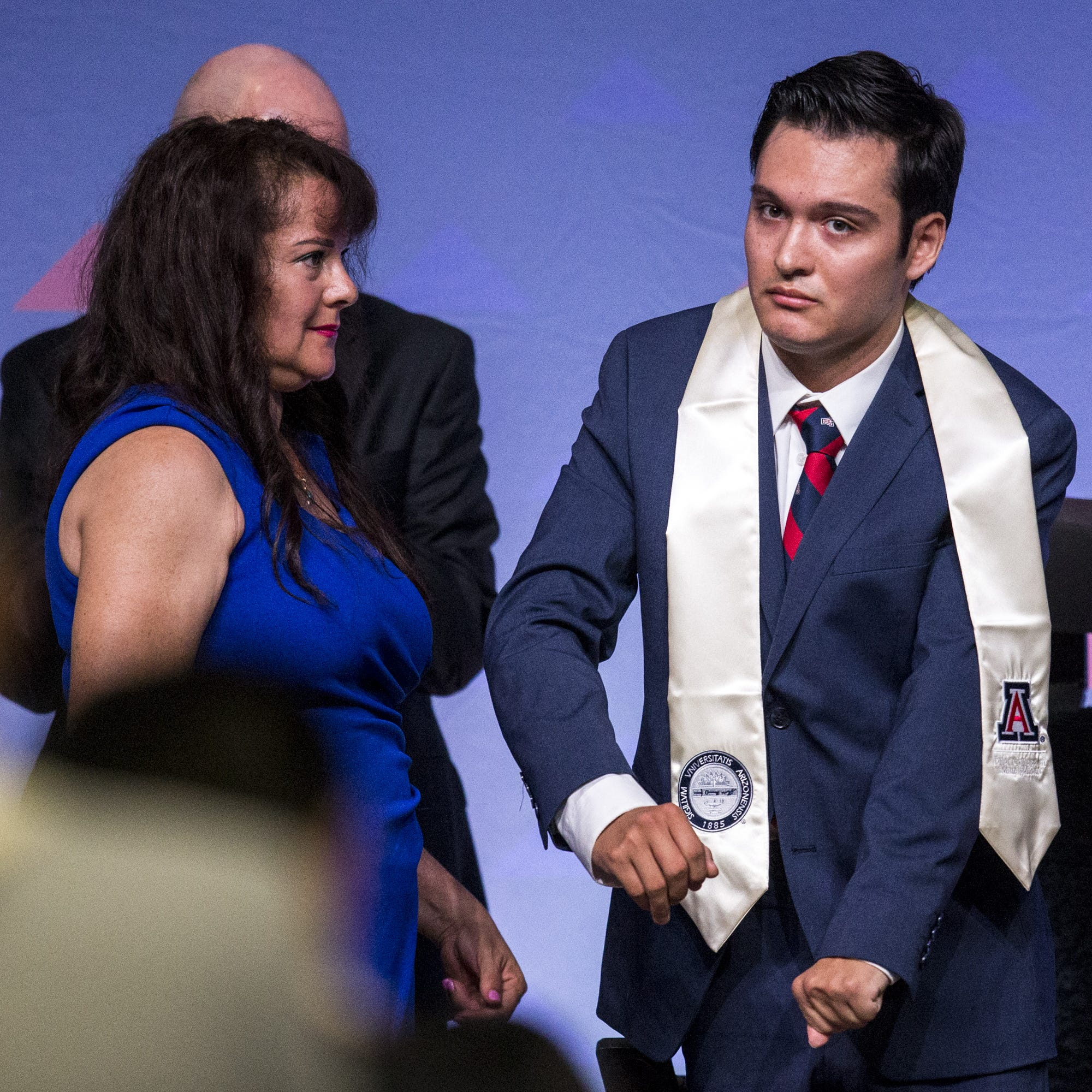 Giant steps: A mother's resolve and a son's grit give a UA student his dream of walking at graduation
